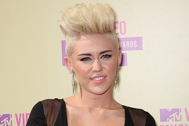 A buzz cut Miley Cyrus at the MTV Awards in September.