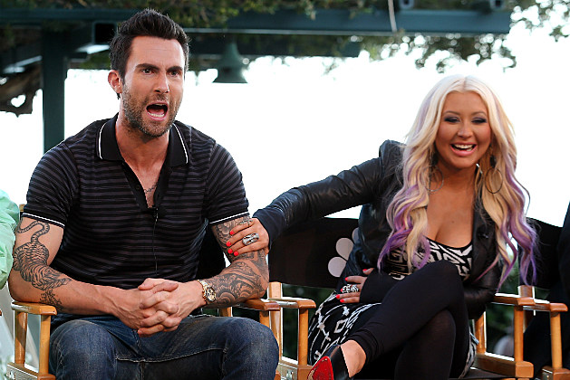 Adam Levine defends fellow coach Christina Aguilera against meanies who talk about her weight.