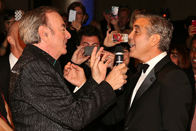 George Clooney proves he's not gay by singing with Neil Diamond.