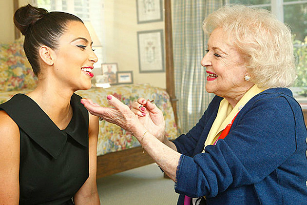 Betty White helps Kim Kardashian with her makeup.