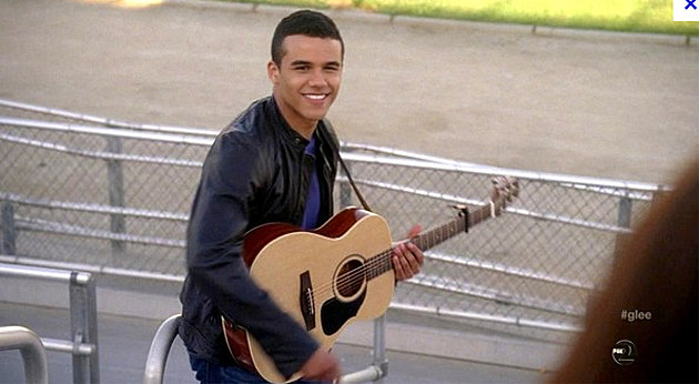 Jacob Artist with a guitar on Glee