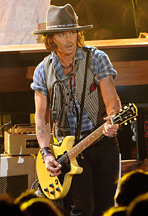 Johnny Depp playing rock god