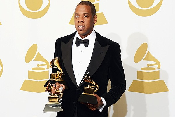 jay z drinks cognac out of his grammy just because he can. Black Bedroom Furniture Sets. Home Design Ideas