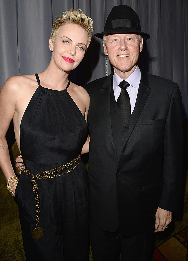 Charlize Theron with Bill Clinton in a fedora at the GLAAD Awards