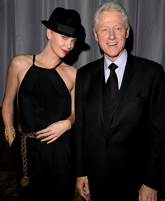 Charlize Theron wearing Bill Clinton's fedora at the GLAAD Awards