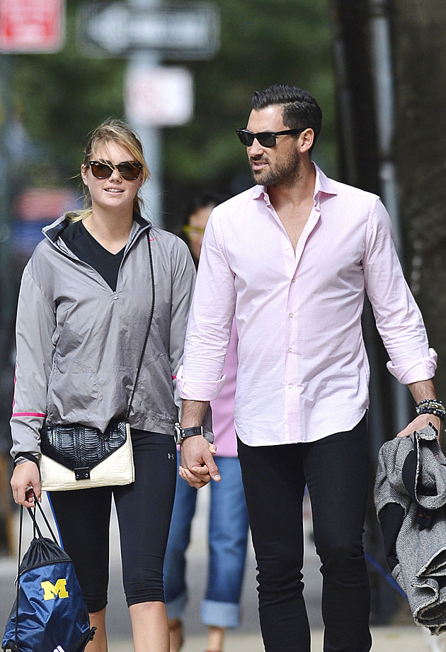 105630, **EXCLUSIVE** NEW YORK, NEW YORK - Thursday September 26, 2013. IT'S ON! Kate Upton and Maksim Chmerkovskiy go public with their love as they go hand-in-hand on a stroll through the West Village in New York City. Rumors regarding the pairs relationship have been swirling for months, but their PDA filled walk appears to confirm their status as a couple. This is the first time the high profile supermodel has been seen engaging in PDA in public with her 'Dancing with the Stars' boyfriend. Photograph: © PacificCoastNews.com